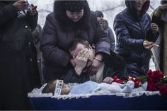 The horrors of war in Ukraine include a father mourning his dead son.