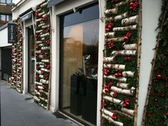 H R Tribbeck & Son is looking very festive. A dressed doorway is a distinctive w. Christmas Store Displays, Christmas Window Display, New Years Decorations, Christmas Decorations, Holiday Decor, Outdoor Christmas, Merry Christmas, Store Windows, Ladder Decor