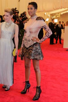Kimberly Chandler in Rodarte dress, Versace shoes, and Lanvin clutch