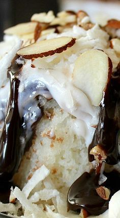 Almond Joy Poke Cake - Easy only 4 ingredients - One Box of White Cake Mix One jar of Hot Fudge Topping One container of White Frosting 2 cups of Sweetened Coconut 1 cup of Sliced Almonds Read more at http://www.ohbiteit.com/2015/02/almond-joy-poke-cake.html#MfPXDy4iVu4vdvW9.99