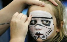 Lawrie Haughton has her face painted as a Storm Trooper at the Star Wars Celebration Europe event in London, Friday July 13, 2007. The Star Wars event bringing enthusiasts and retailers together in London, runs from July 13-15. (AP Photo/Alastair Grant) Photo: ALASTAIR GRANT, STF / AP2007