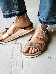 High-shine Birkenstocks with metallic leather straps and monochromatic buckles. Soft Footbed design features an added layer of foam on top of the signature contoured cork footbed for extra cushioning.