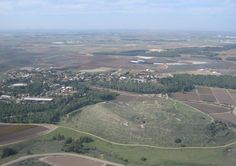 """An aerial view of Tel Lachish """"The Canaanite city of Lachish was one of the most important centers in the world for the use of the alphabet,"""" and preserved the culture of using an egalitarian writing system, Garfinkel said. Earlier writing systems, like Sumerian cuneiform or Egyptian hieroglyphs, demanded years of study and were comprehensible only to an elite cadre of scribes. Alphabets were far more accessible to all."""