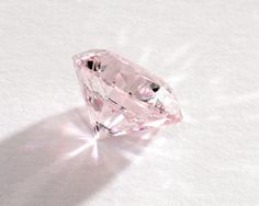 The top lot of the auction was a 5.08-carat round brilliant, fancy light pink diamond of VVS2 clarity (below), which sold for $1.4 million, or $280,807 per carat, after a pre-sale high estimate of $ 700,000.