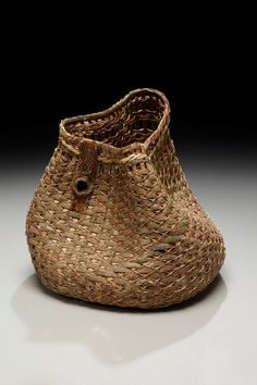 Sculptural Art Basket by Matt Tommey made from mimosa bark, poplar bark and copper wire with a royal paulownia bark accent.