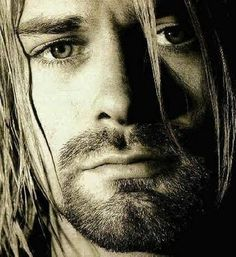 Cobain's look is not a come hither look. It is the look of a tortured soul, confused, lost. So sad he couldn't get help. kn