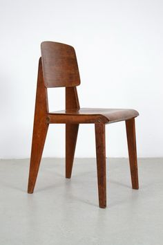 Jean Prouvé; Oak and Powder-Coated Steel Standard Chair for Vitra, 1930.