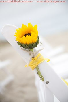 could be an extremely affordable way to incorporate flowers into a beach ceremony.  have someone gather the flowers after ceremony and add to a vase on the entrance table.  use something other than sunflowers.