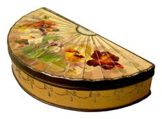 gold colored with pansies, British biscuit tin