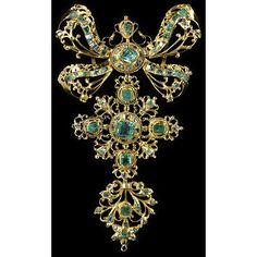 1750: Slide and pendant with table-cut emeralds set in gold openwork.