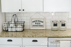 How to add vintage style to a builders grade kitchen by A Bowl Full of Lemons Like the simple coffee cup corner/storage.