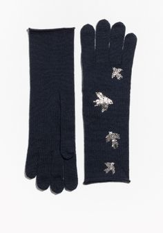 A flock of silvery swallows embellishes these soft and well-fitted wool gloves designed with an extended cuff for added warmth.