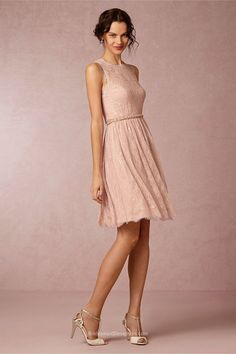 Chic dusty pink knee length bridesmaid dress features intricate overall lace fabric. Illusion jewel neckline on sleeveless bodice, eye-catching belt at front waist, short A-line skirt with eyelash edge finishing off the look. Keyhole back, side zip.  <br>