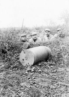 French soldiers with a German unexploded 220-mm projectile. The Somme, 1916.