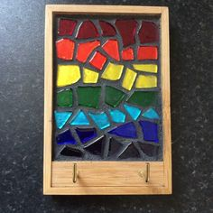 A stained glass key rack measuring 4 x 5 inches made from a panel of rainbow coloured glass mosaic pieces finished in a dark grey grout ,mounted in a bamboo frame.There are two brass coloured hooks for your keys or dog leads or even a combination of th. Mosaic Glass, Stained Glass, Grey Grout, Mosaic Pieces, Key Rack, Brass Color, Colored Glass, Rainbow Colors, Gift Guide