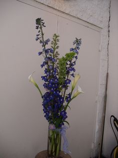 Blue , white flowers arrangement for wedding and events.