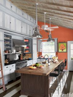 "Add Some Excitement to the Floors ""Tomato-soup red"" walls and hand-painted striped floors pack a lot of personality into Liza Pulitzer Calhoun's Palm Beach kitchen. Brown floor paint is Benjamin Moore's Bittersweet Chocolate Red Kitchen Walls, Kitchen Colors, Orange Kitchen, Kitchen White, Kitchen Paint, Country Kitchen, Smart Kitchen, Beach Kitchens, Cool Kitchens"