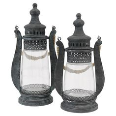 Cast a flickering glow over your three-season porch or craft a rustic vignette on your hall console table with these antique-inspired candle lanterns, showca...