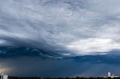 """Earlier in July 2014, storm chaser Alex Schueth captured a mesmerizing time-lapse of undulatus asperatus clouds rolling over Lincoln, Nebraska during a storm. The rare cloud formation, whose name means """"roughened or agitated waves,"""" looks like a sea of dark and stormy waters churning ominously in the sky."""