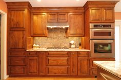 This kitchen has a traditional look with slate tile for the back splash.  The cabinetry is knotty alder with a glazed finish.