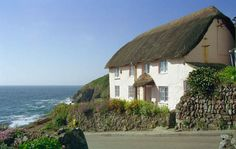 Cottage in Cornwall, England by the sea