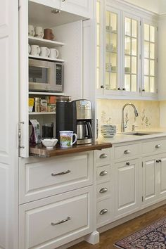 Hakansson: Creative Kitchen Storage Solutions a coffee center located on a counter-height pullout shelf and a microwave on a shelf above.a coffee center located on a counter-height pullout shelf and a microwave on a shelf above. Kitchen Storage Solutions, Diy Kitchen Storage, Kitchen Redo, Kitchen Pantry, Kitchen Organization, New Kitchen, Storage Organization, Storage Ideas, Kitchen Ideas