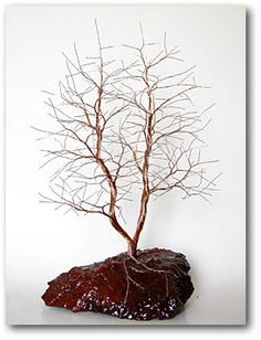 copper wire tree on natural rock base