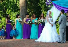 I like the way the bridesmaids are rotating between the two colors, possibly just have maid of honor and junior brides maids in purple everyone else in turquoise