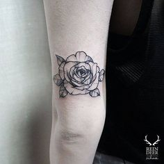 Blackwork style rose tattoo on the back of the left arm. Done by Zihwa