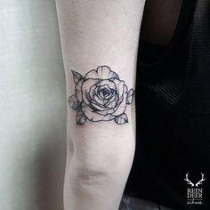 "cutelittletattoos: "" Blackwork style rose tattoo on the back of the left arm. Tattoo artist: Zihwa """