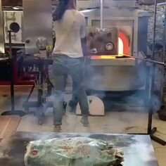 Molten hot glass is being used to cook fish over 1100c