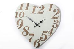 This practical and stylish heart shaped wooden wall clock is a stylish addition to any home The face is cream with brown Arabic numerals and fancy