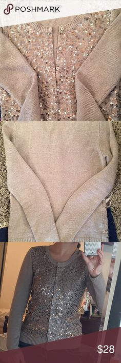 Ann Taylor gray sequined sweater Ann Taylor gray and pearly sequined sweater. Size M. Can be a cardigan in that it buttons up the center. Sleeves and back of sweater are not sequined. EUC Ann Taylor Sweaters Cardigans
