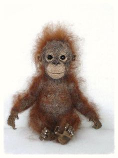 This artist's work is remarkable. Needle Felted Baby Orangutan by FireflyFelts on Etsy