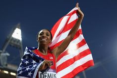 Silver medalist Lashinda Demus of the United States celebrates afte the Women's 400m Hurdles Final on Day 12 of the London 2012 Olympic Games at Olympic Stadium on August 8, 2012 in London, England.