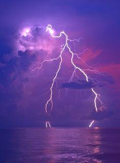 Lightning in a purple sky.