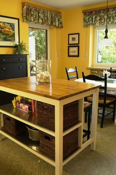 Kitchen Island.  Use baskets to store potatoes and onions in baskets under island shelf and to store plastic containers.