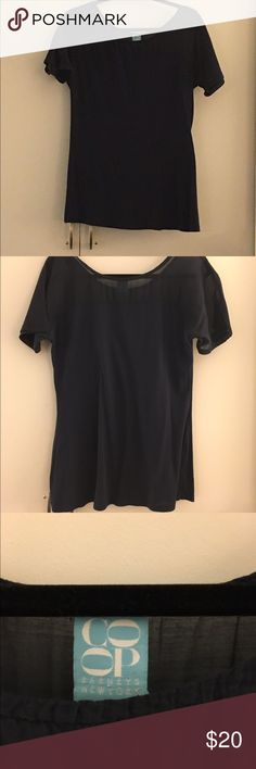 Barneys Navy Tee Pre-owned - great condition with no stains or holes. Navy tee with silk shoulder and sleeves.  Body made of 100% cotton and shoulders and sleeves made 100% silk Size small Measurements: Underarm to underarm is approximately 19 inches Shoulder to hem is approximately 28 inches  🎉20% discount on all bundles🎉 ❌No trades❌ Barneys New York CO-OP Tops Tees - Short Sleeve