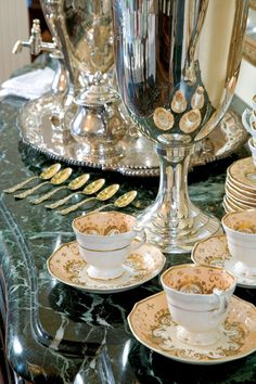 A shining silver tea service set alongside your favorite china teacups and saucers is a lovely addition to a refined sideboard.