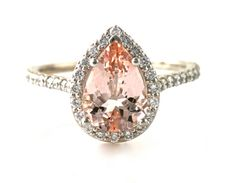 Diamonds in this beautiful ring. It's available in your choice of 14K White, Yellow or Rose Gold. The natural Morganite is approximately 1.5cts and measures 10x7mm. There are 1/2ct of diamonds in the halo and shank. Only 1,120 Dollars!    This ring would make a beautiful engagement ring. The matching wedding band is also available. Ask for a quote.