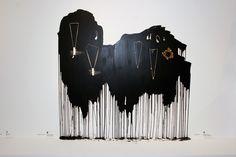 Gallery display: Black paint dripping down wall   Kateřina Vorlová : Křídové objekty a Janja Prokić : Kolekce Květy