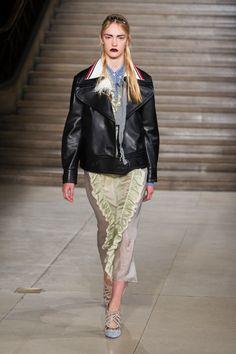 Leather jackets, delicate skirts, and dark lips at Miu Miu.