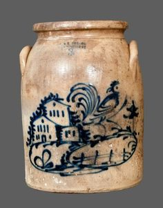 """Sold For $ 2,700 Very Rare Three-Gallon Stoneware Jar with Elaborate Cobalt Rooster, House, and Fence Decorations, Stamped """"J. & E. NORTON / BENNINGTON, VT.,"""" circa 1855, cylindrical jar with lug handles, the front decorated with an elaborate slip-trailed farm scene, including a rooster with turned head, a split-rail fence, and three houses, surrounded by cobalt highlights. An exceptional decoration. In need of restoration with heavy flaking and staining throughout. Fortunately, majority of…"""