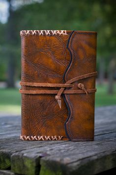 Rich Chestnut leather dyes and polished vegtan leather combined with a classic whipstitched edging provides distinction for this custom journal. Black suede lining and refillable with your choice of Handmade or Lined paper selections.