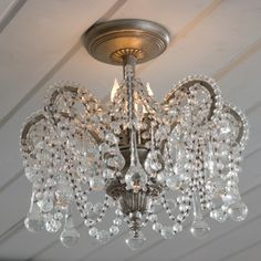 Rachel Ashwell Shabby Chic Couture Crown Chandelier.  I would love these instead of the boob lights on my ceilings.