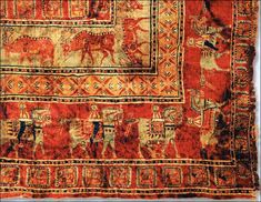 The most ancient in the world - fleecy carpet found in one of Pazyryk mounds, currently on display in Hermitage. Institute of Archeology and...