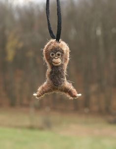 Tiny Orangutan Necklace  needle felted by motleymutton on Etsy