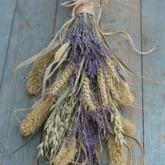 Rustic dried lavender bouquet with grasses, wheat and oats