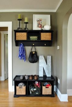 Organizing a small entryway.  Shoe-storage included.