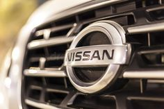 Nissan logo on a car. ABU DHABI, UAE - NOV 26, 2016: Nissan company logo on a ca , #ad, #ABU, #DHABI, #UAE, #Nissan,